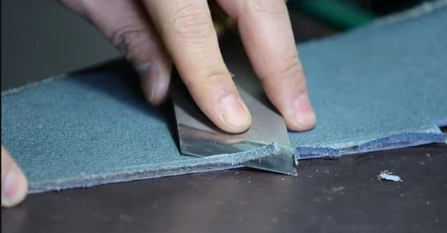 Cut a small leather strip